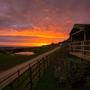 Romantic sunset at Giraffe Lodge overnight safari experience at Port Lympne Hotel and Reserve in Kent