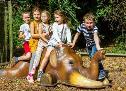 Kids having fun at Dinosaur Forest at Port Lympne Hotel & Reserve in Kent