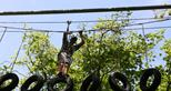 Tyre traverse on the Treetop Challenge at Howletts Wild Animal Park in Kent