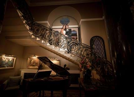 Beautiful wedding photography on the grand staircase at Kent wedding venue, Port Lympne Hotel & Reserve